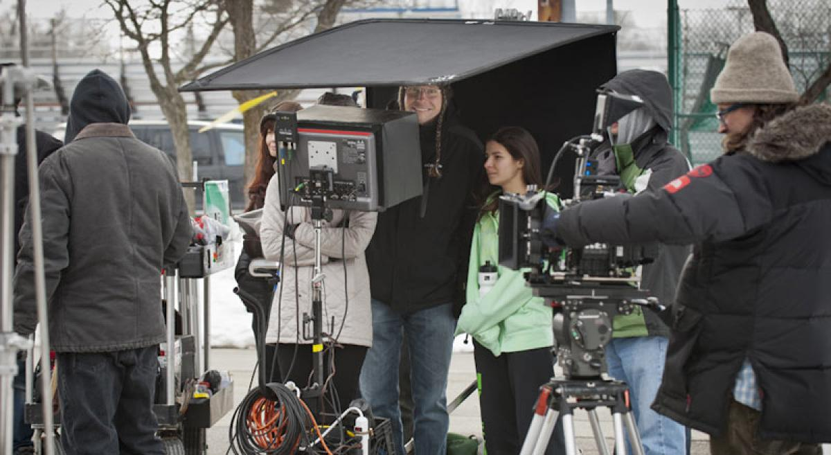 Bill Latka directing a TV commercial on a cold day